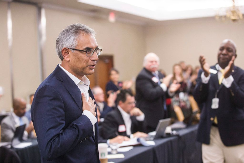 Dr. Shahid Shafi speaks before members of the State Republican Executive Committee following a vote Dec. 1 in favor of resolution that opposes an effort by the Tarrant County Republican Party to remove him as vice chair because of his religion. Email exchanges involving county Republican leaders in Texas reveal efforts to remove Shafi, a party vice chairman because he's Muslim.