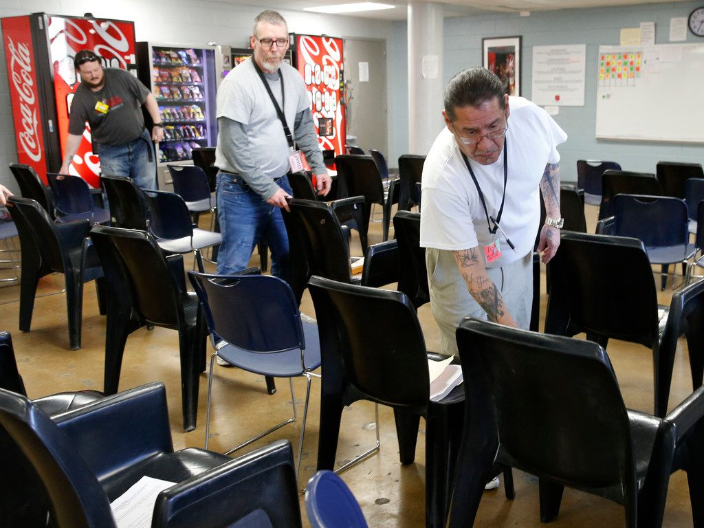 David Pintor (right) works on putting the chairs in place before the next class in the substance abuse program of the Carr P. Collins Social Service Center operated by the Salvation Army in Dallas.