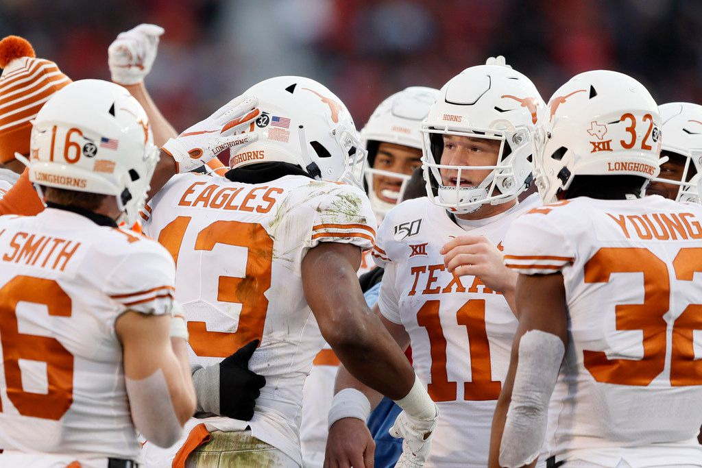 Texas wide receiver Brennan Eagles (13) celebrates with quarterback Sam Ehlinger (11) after catching a 14-yard touchdown pass during the Longhorns' 23-21 loss to Iowa State, Saturday, Nov. 16, 2019, in Ames, Iowa.