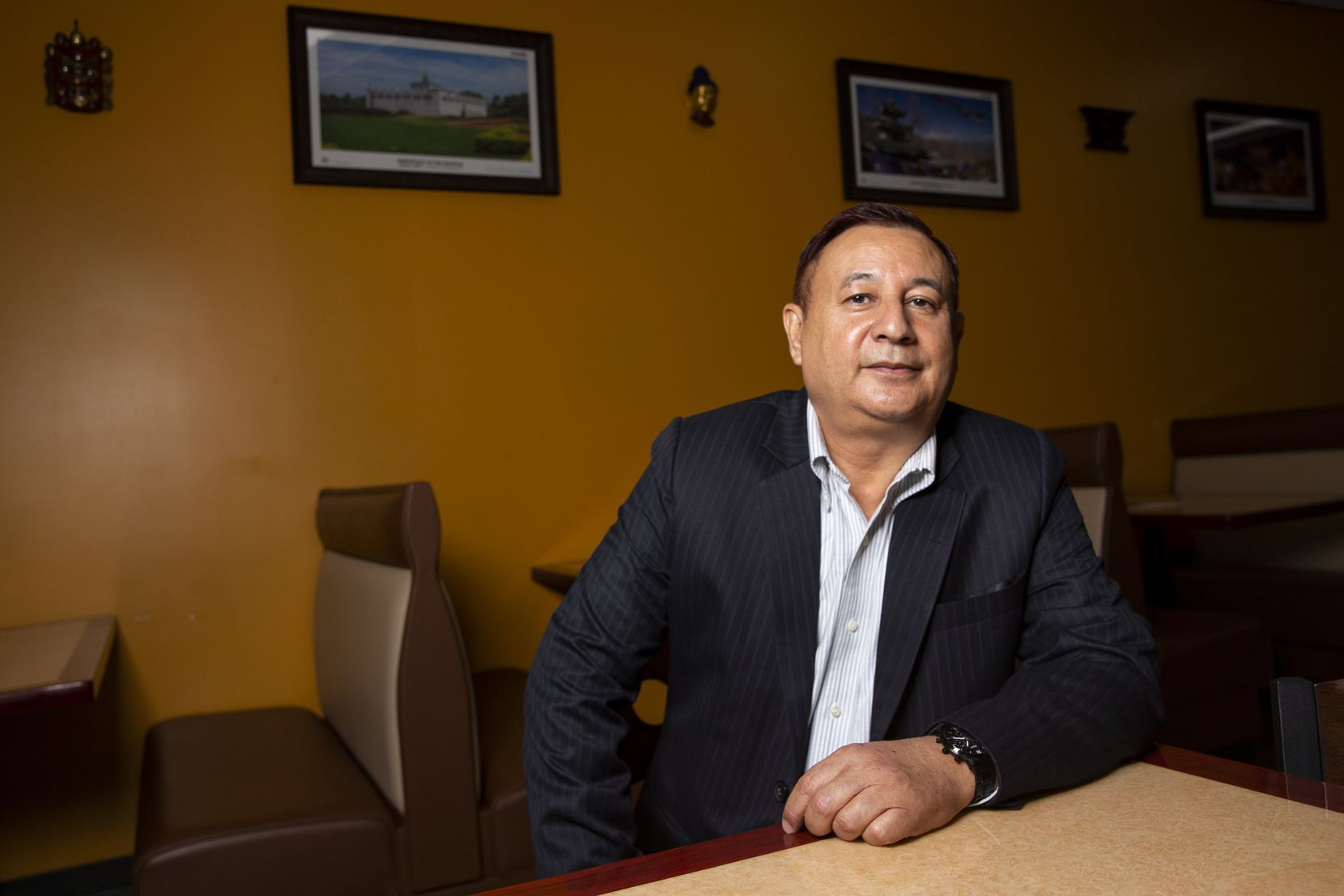 Mohan Gyawali Chhetri, a voter in the 24th Congressional District, poses for a photo at The Gurkha Bar & Grill in Euless.