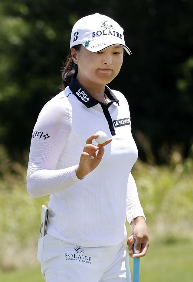 Professional golfer Jin Young Ko waves after finishing her round of 8-under during the opening round of the LPGA VOA Classic at the Old American Golf Club in The Colony, Texas, Thursday, July 1, 2021. (Tom Fox/The Dallas Morning News)