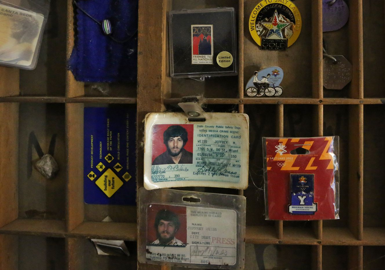 A printer's tray holds press ID cards and other mementos from Jeffrey Weiss' career at his home in Dallas.