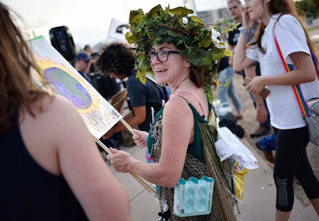 "Patricia Brown, 49, of Midlothian, a green advocate, wears her Halloween costume of recyclable items titled, ""Pissed off Mother Earth,"" during the Global Climate Strike rally near the Margaret Hunt Hill Bridge in Dallas, Sept. 20, 2019."