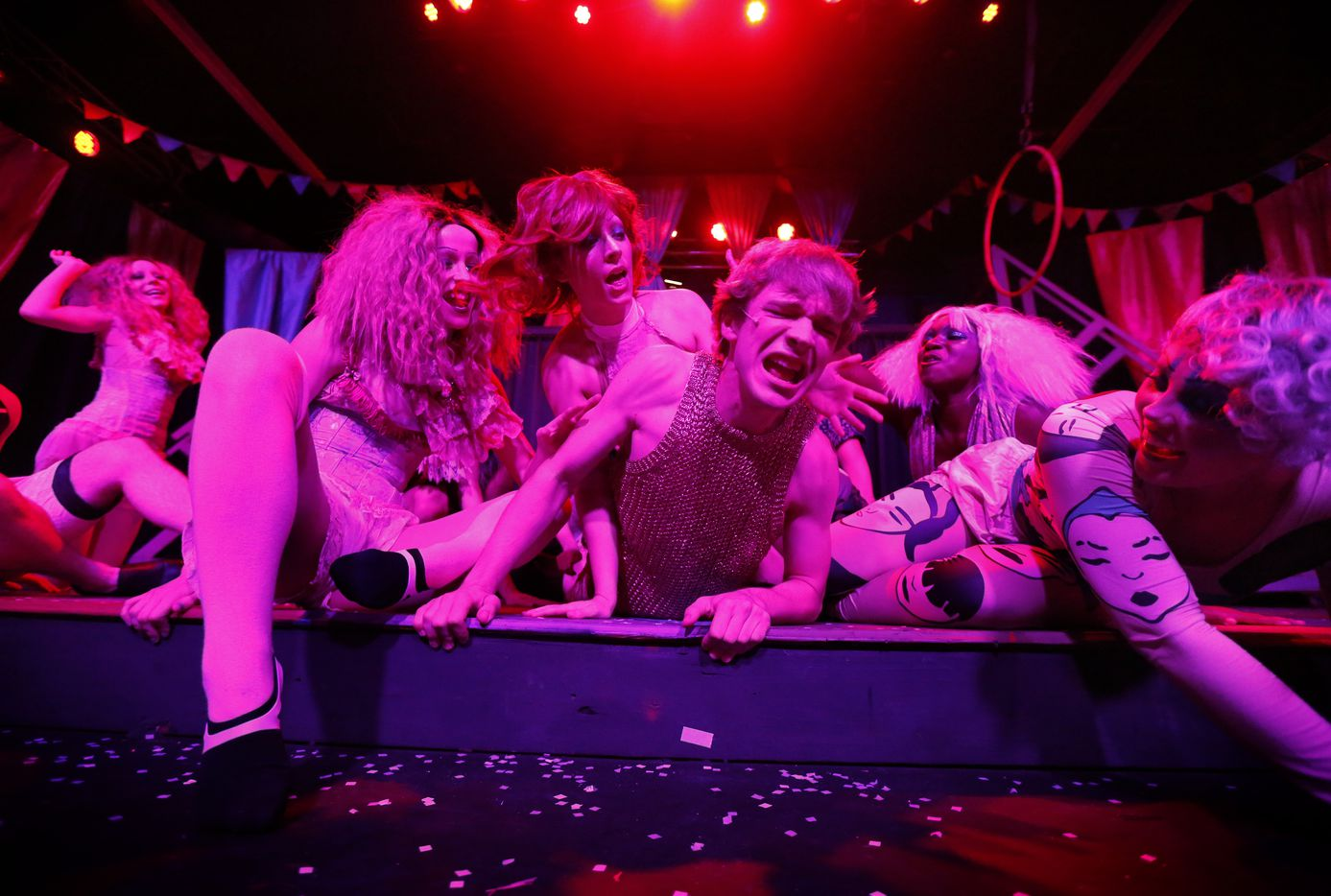 Actor Will Carleton (center), playing Pippin, fights his way through adoring women during a dress rehearsal.