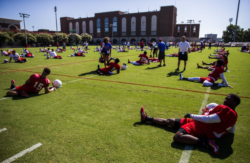 The SMU football team stretches before practice on Thursday, August 4, 2016 at the Pettus Practice Fields at Southern Methodist University in Dallas.  (Ashley Landis/The Dallas Morning News)