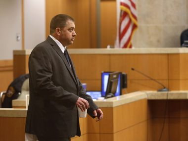 Robert Veal walks to his seat during his capital murder trial in the 199th judicial district court of Collin County Courthouse in McKinney, Texas on Thursday, January 30, 2020. (Vernon Bryant/The Dallas Morning News)