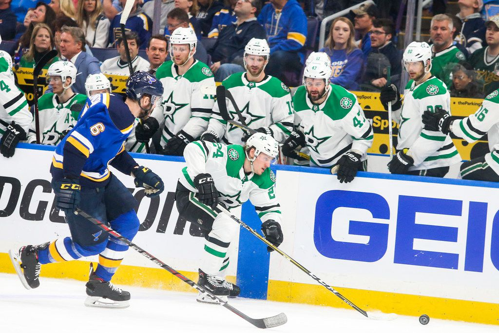 Stars left wing Roope Hintz (24) drives the puck past his team's bench while defended by St. Louis Blues defenseman Joel Edmundson (6) during Game 2 of a second-round playoff series at Enterprise Center in St. Louis on Saturday, April 27, 2019. (Shaban Athuman/Staff Photographer)