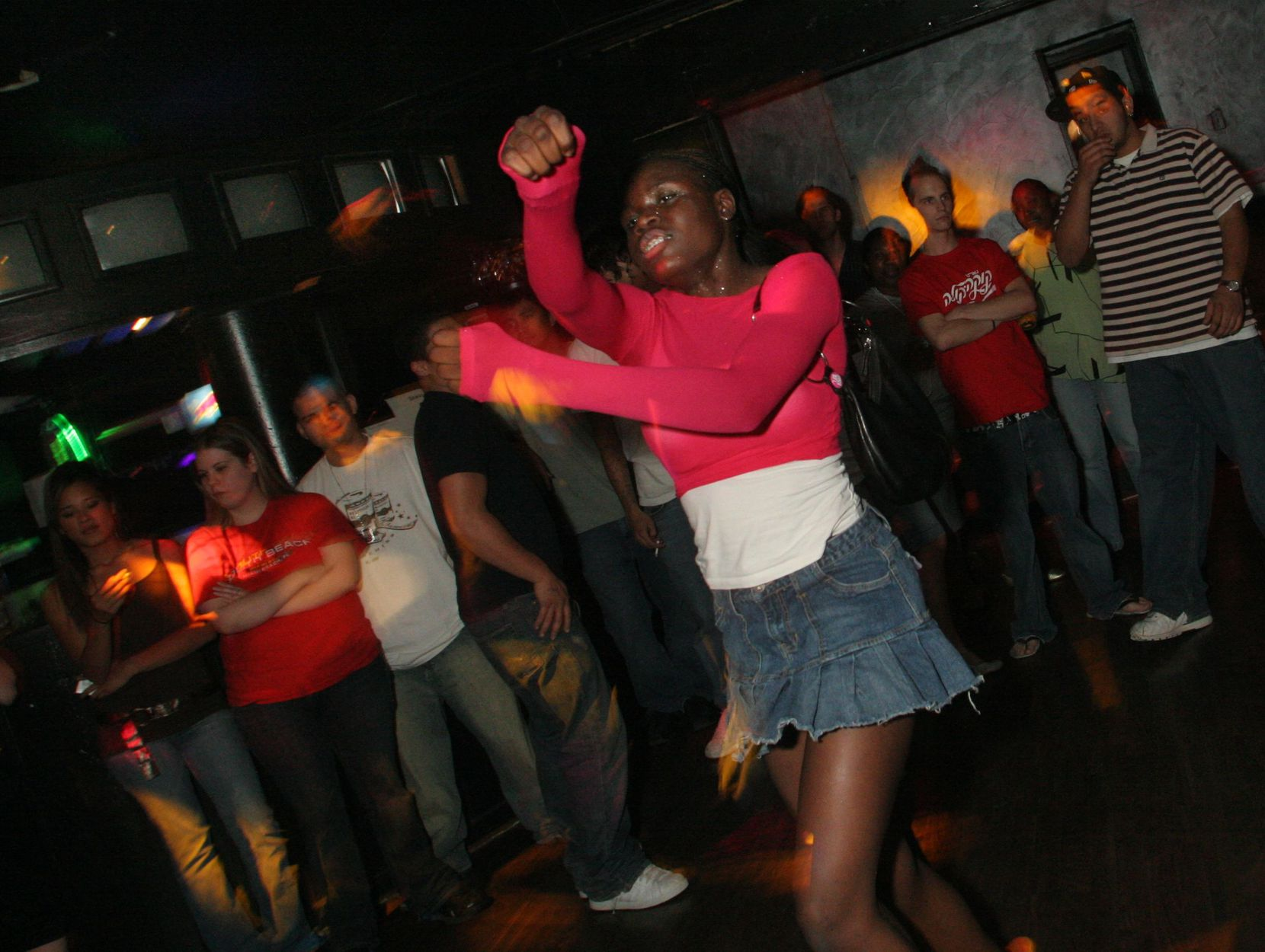 "A woman who calls herself ""Ray of Light"" dances at the Lizard Lounge in 2006."