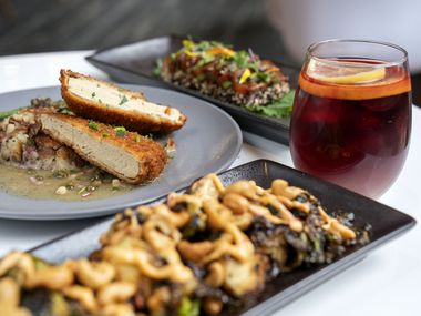 Panko-crusted piccata is served at Belse Plant Cuisine in Dallas alongside cashew Brussels sprouts, foreground, a smoked sangria drink and a watermelon ahi plate.