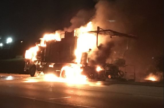 Construction equipment blazes on Loop 820 in Fort Worth on Tuesday morning.