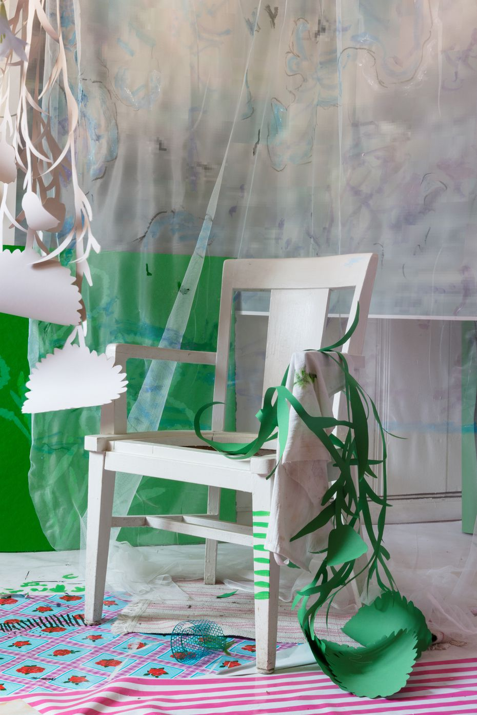 """In works like """"Big Chair,"""" artist David Gilbert creates installations using materials such as furniture, paper cutouts, swaths of fabric, stickers, yarn, and handmade sculptures and paintings — which he then photographs, displaying only the finished prints."""