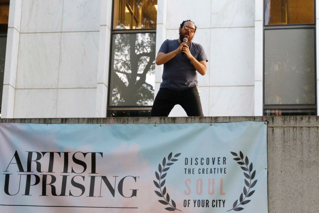 Host Randy Guthmiller announces to the crowd that more bands will play at the Artist Uprising Presents: The Dallas Music Experience at Harry C. Beck Jr. Park in downtown Dallas on Friday April 7, 2017. (Ron Baselice/The Dallas Morning News)