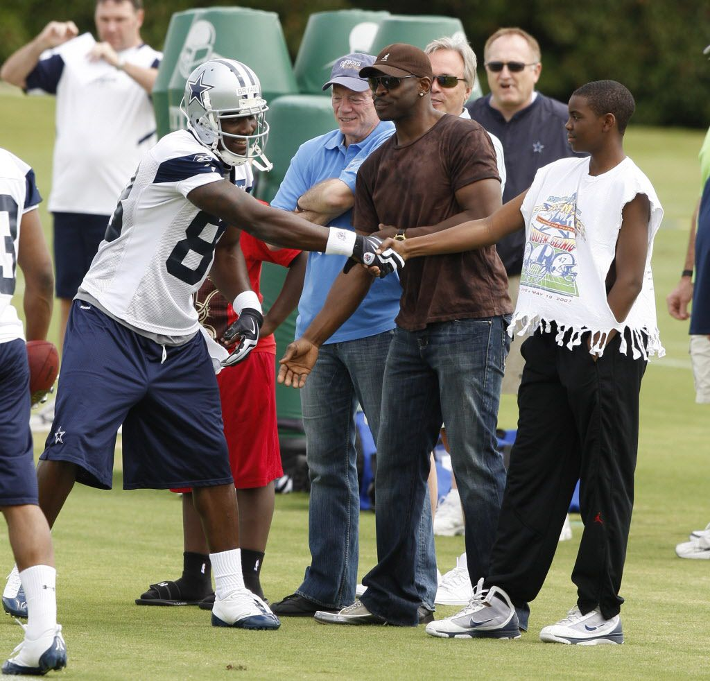 Dez Bryant shakes hands with Michaal Irvin's son Michael at Cowboys Mini Camp at Valley Ranch In Irving Saturday May 1, 2010. (Special to the Star-Telegram/ Richard W. Rodriguez)