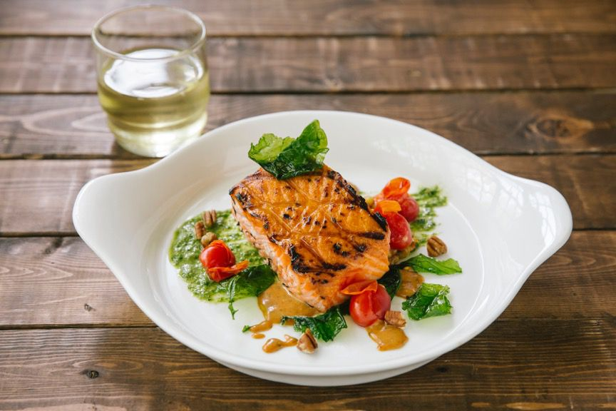 The wood-kissed salmon -- fancy! -- comes with carrots and a kale-and-carrot-top pesto with pit field peas.