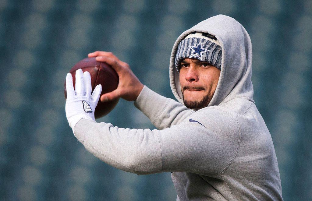 Dallas Cowboys quarterback Dak Prescott warms up before an NFL football game against the Philadelphia Eagles on Sunday, Dec. 31, 2017, in Philadelphia. (Smiley N. Pool/The Dallas Morning News)
