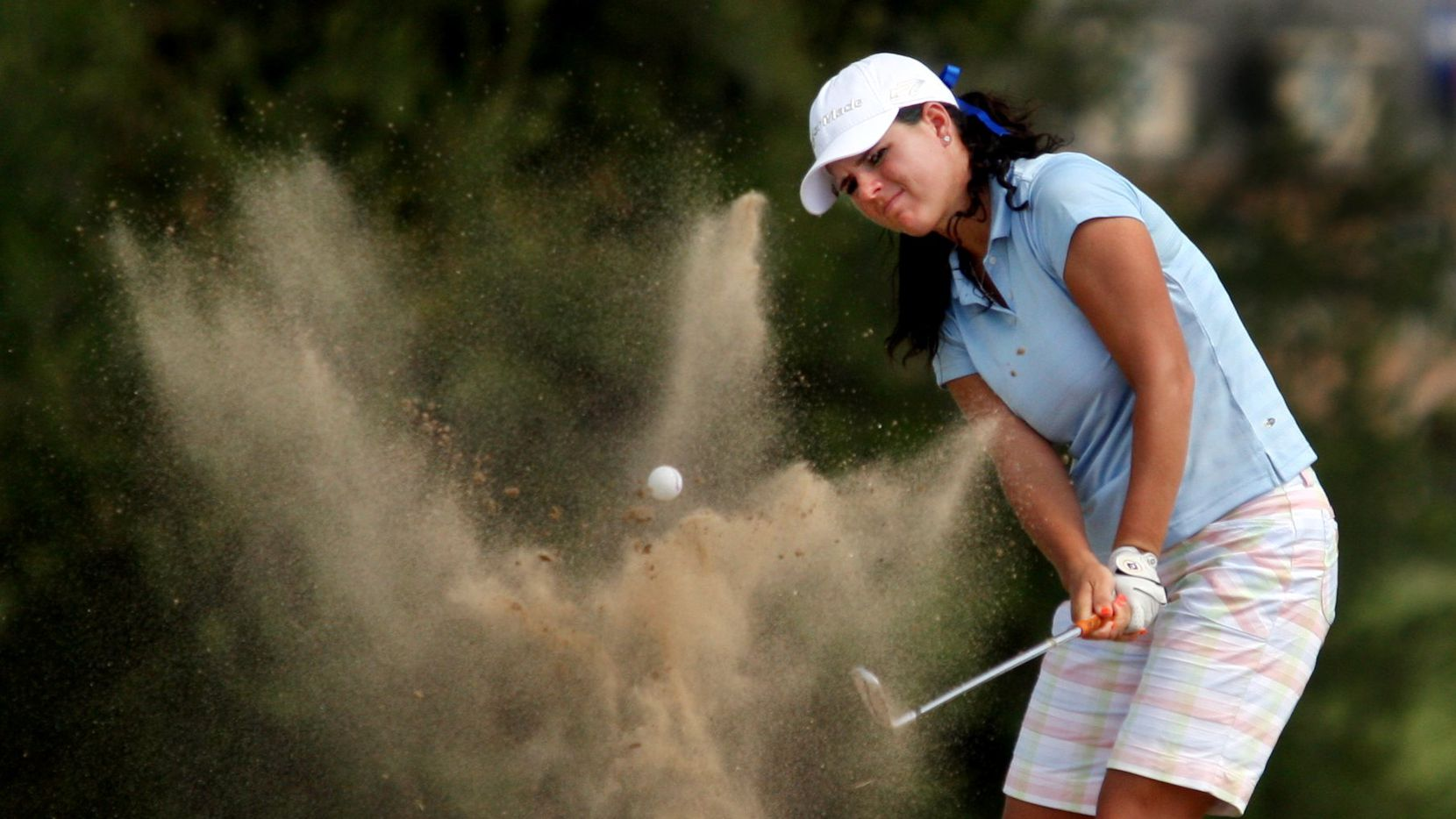 Caney  Hines of San Antonio blasts out of a bunker on the 18th hole during competition in Texas Women's Open at the Eastern Hills Country Club in Garland.