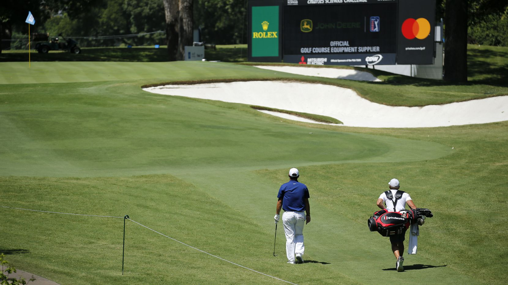 Golfer Patrick Reed and his caddie walk alone up the par-3 No. 8 during a Charles Schwab Challenge practice round at Colonial Country Club in Fort Worth on Tuesday, June 9, 2020. Reed played the round without playing partners. The Challenge is the first PGA Tour event since the COVID-19 pandemic began.