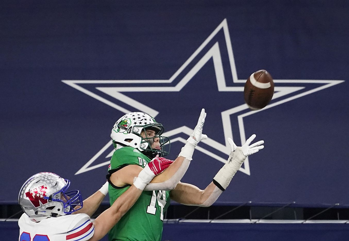 Austin Westlake defensive back Beau Breathard (23) breaks up a pass intended for Southlake Carroll wide receiver Brady Boyd (14) during the fourth quarter of the Class 6A Division I state football championship game at AT&T Stadium on Saturday, Jan. 16, 2021, in Arlington, Texas. Westlake won the game 52-34.