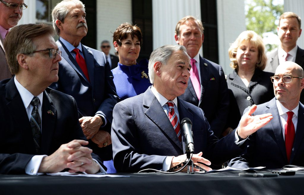 Gov. Greg Abbott (center), Lt. Gov. Dan Patrick (left), Speaker of the House Dennis Bonnen (right) and other lawmakers attended a joint news conference to discuss teacher pay and school finance at the Texas Governor's Mansion in Austin on May 23, 2019.