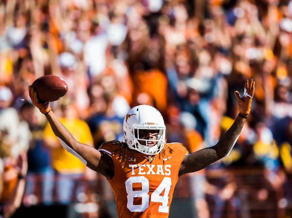 Texas Longhorns wide receiver Lil'Jordan Humphrey (84) celebrates a touchdown during the first quarter of a college football game between the University of Texas and West Virginia on Saturday, November 3, 2018 at Darrell Royal Memorial Stadium in Austin, Texas. (Ashley Landis/The Dallas Morning News)