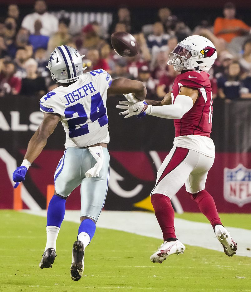Arizona Cardinals wide receiver Christian Kirk (13) hauls in a long pass as Dallas Cowboys cornerback Kelvin Joseph (24) defends during the first quarter of an NFL football game at State Farm Stadium on Friday, Aug. 13, 2021, in Glendale, Ariz.