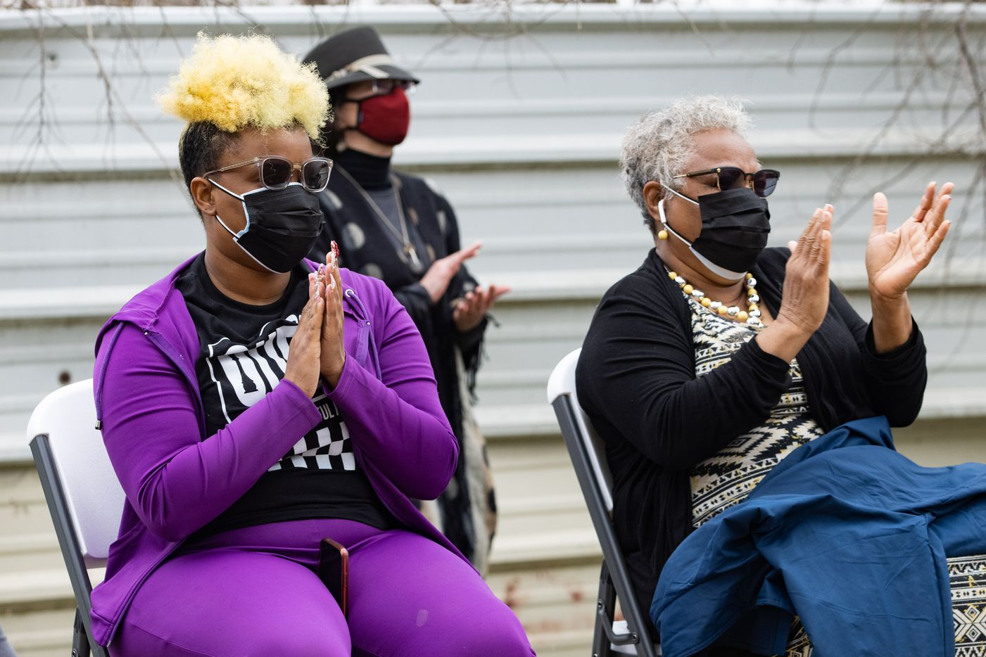 Marsha Jackson (right) and daughter LaKeisha Jackson clap after Shaun Martin performed outside of Jackson's home in Dallas on Friday, Feb. 26, 2021. Quincy Roberts, the contractor who moved Shingle Mountain, surprised Jackson with the concert. (Juan Figueroa/ The Dallas Morning News)