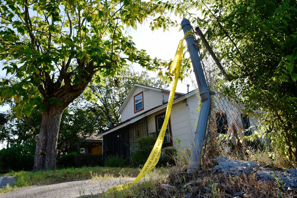 Crime scene tape remained outside of a house on Aug. 18, 2019, on the 4200 block of Jamaica Street in Dallas, where 27-year-old Schaston Hodge was fatally shot by two Department of Public Safety troopers.