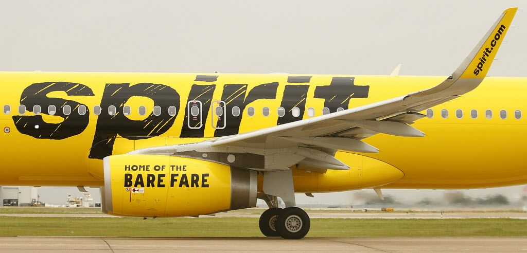 A Spirit Airlines passenger jet, with the 'Home of the Bare Fare' slogan on the jet engine takes off from Dallas Fort Worth International Airport, Thursday, May 7, 2015.