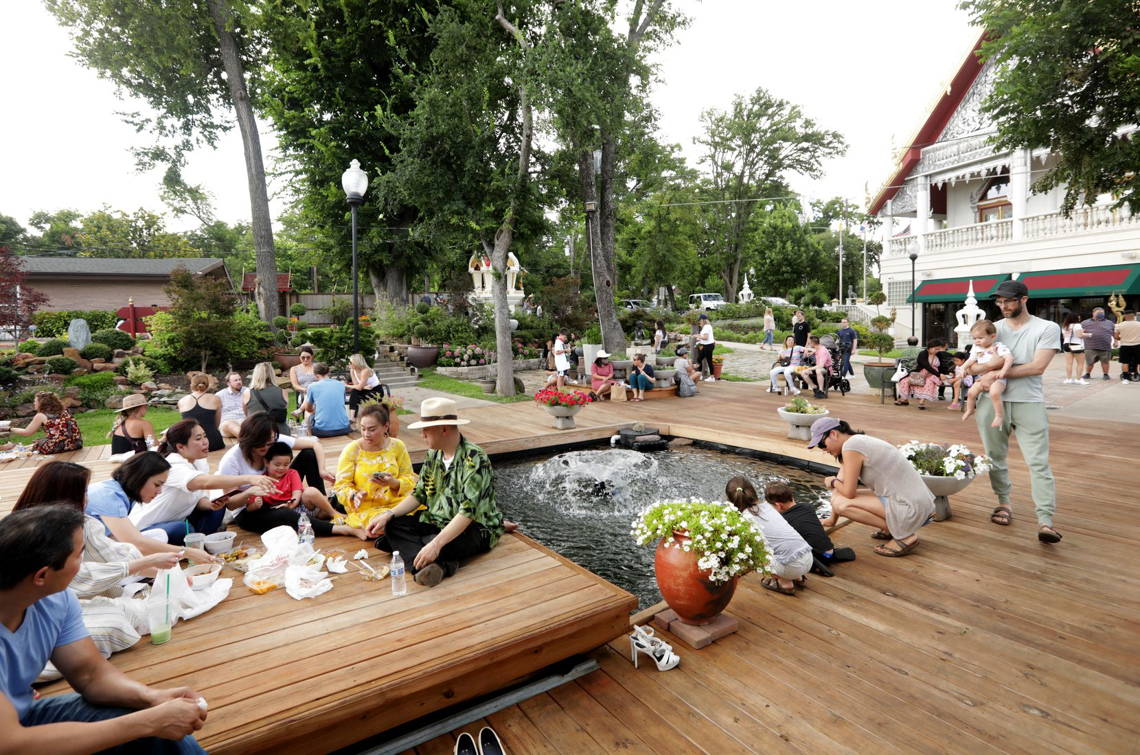 Guests enjoy the food and atmosphere during the Sunday Thai Food Market.