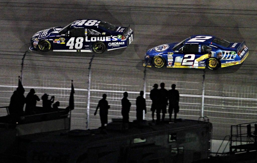 Sprint Cup Series driver Jimmie Johnson (48) pulls ahead of Brad Keselowski to take the lead on the final lap during the AAA Texas 500 Sunday, November 4, 2012 at Texas Motor Speedway in Fort Worth.