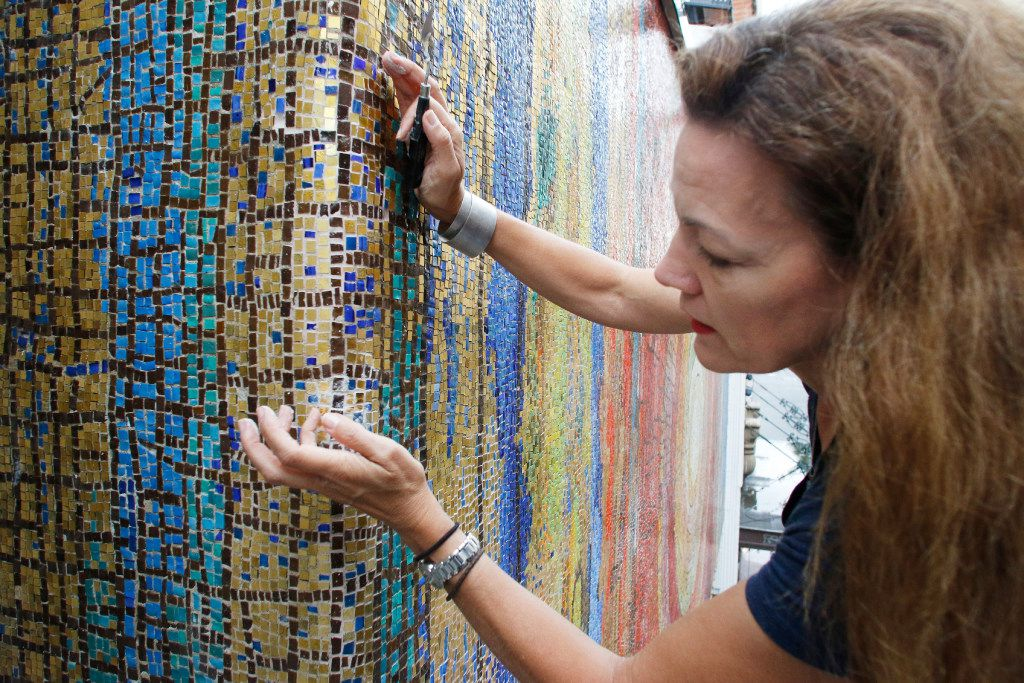 Julie Richey, a mosaic artist works on the exterior mosaic at St. Jude Chapel on Main Street in downtown Dallas on June 9.