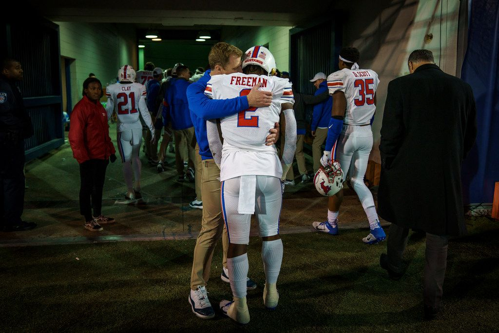 SMU running back Ke'Mon Freeman (2) is consoled by a coach as the Mustangs leave the field after a loss to Memphis in an NCAA football game at Liberty Bowl Memorial Stadium on Saturday, Nov. 2, 2019, in Memphis, Tenn. (Smiley N. Pool/The Dallas Morning News)