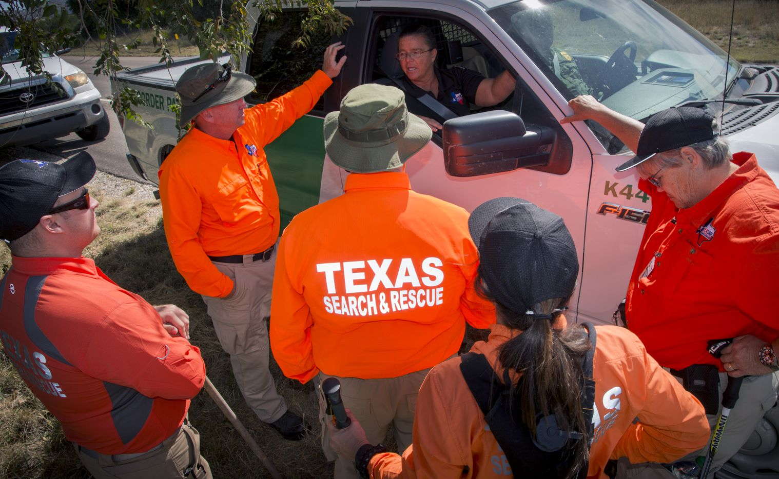 Dawn Keller (in vehicle), West Texas Division Leader of Texas Search and Rescue speaks with fellow team members searching Saturday, Oct. 22, 2016 for Zuzu Verk.