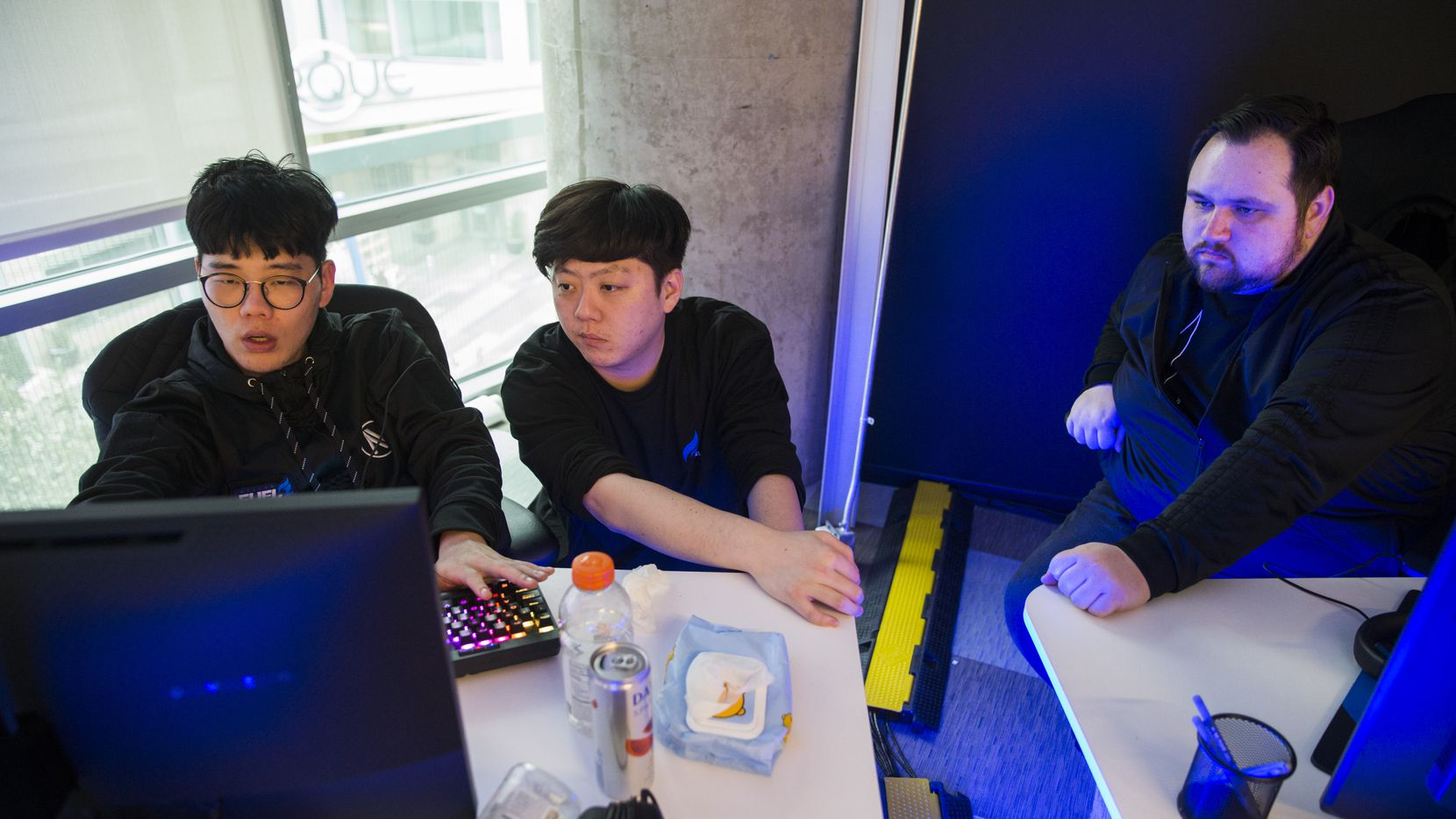 """Dallas Fuel Assitant Coach Kim """"Yong"""" Yong-Jin (left), Assistant Coach Dang """"Vol'Jin"""" Min-Gyu, and Head Coach Aaron """"Aero"""" Atkins (right) practice on Wednesday, January 29, 2020 at Envy Gaming headquarters in Dallas."""