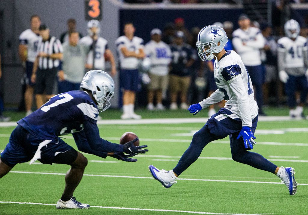 Dallas Cowboys wide receiver Devin Smith (15) misses a pass that falls in to the hands of defensive back Donovan Wilson (37) during a Dallas Cowboys training camp practice on Thursday, August 22, 2019 at The Star in Frisco. (Ashley Landis/The Dallas Morning News)