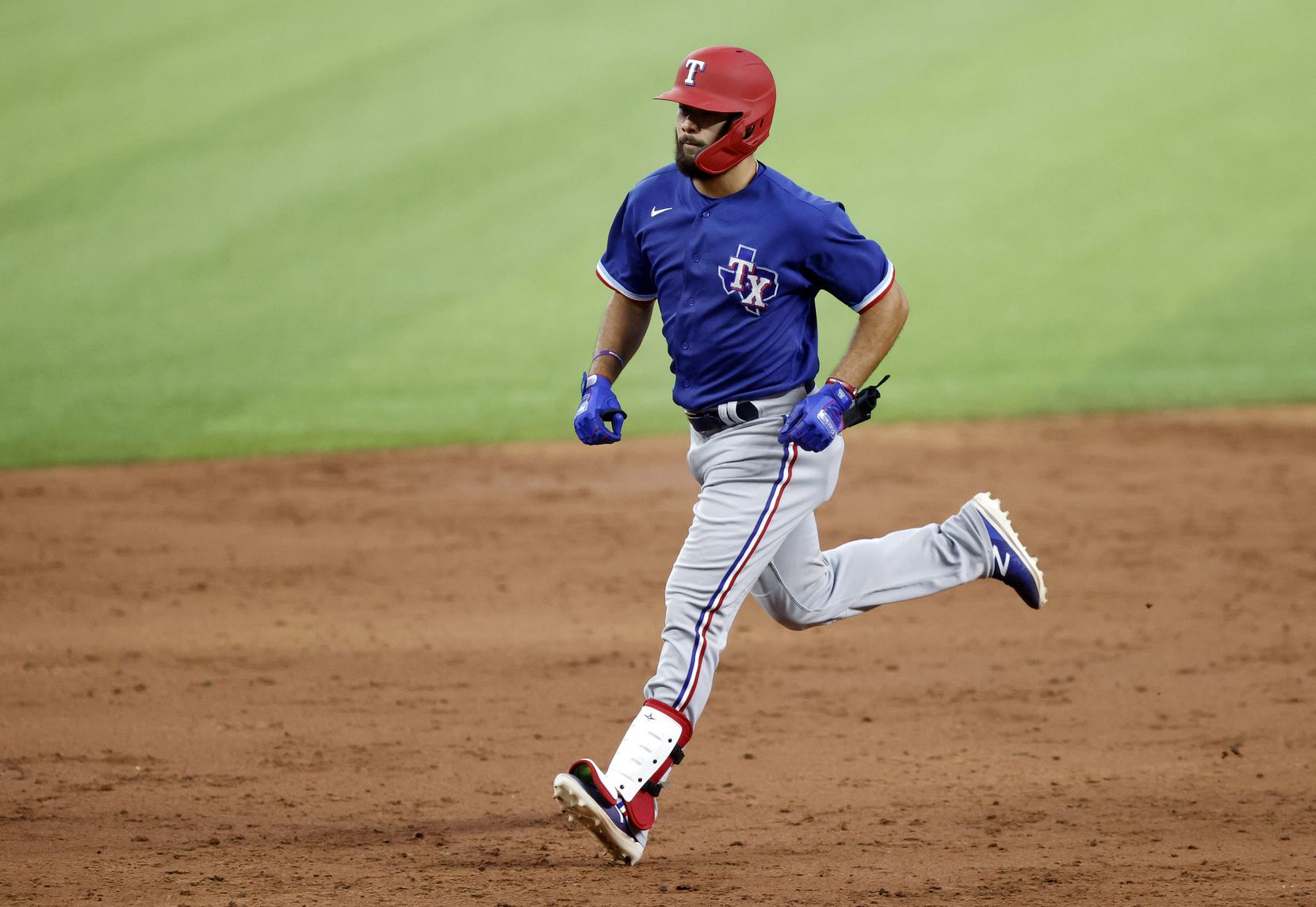 Texas Rangers Isiah Kiner-Falefa rounds the bases after his home run during a simulated Summer Camp game inside Globe Life Field in Arlington, Texas, Thursday, July 9, 2020.