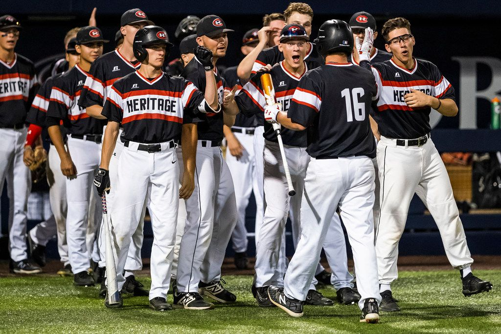 Colleyville Heritage third baseman Mason Greer (16) celebrates with teammates after scoring during game one of a best-of-three Class 5A Region I quarterfinal baseball playoff series against the Mansfield Legacy at Dallas Baptist University on Thursday, May 16, 2019, in Dallas. (Smiley N. Pool/The Dallas Morning News)
