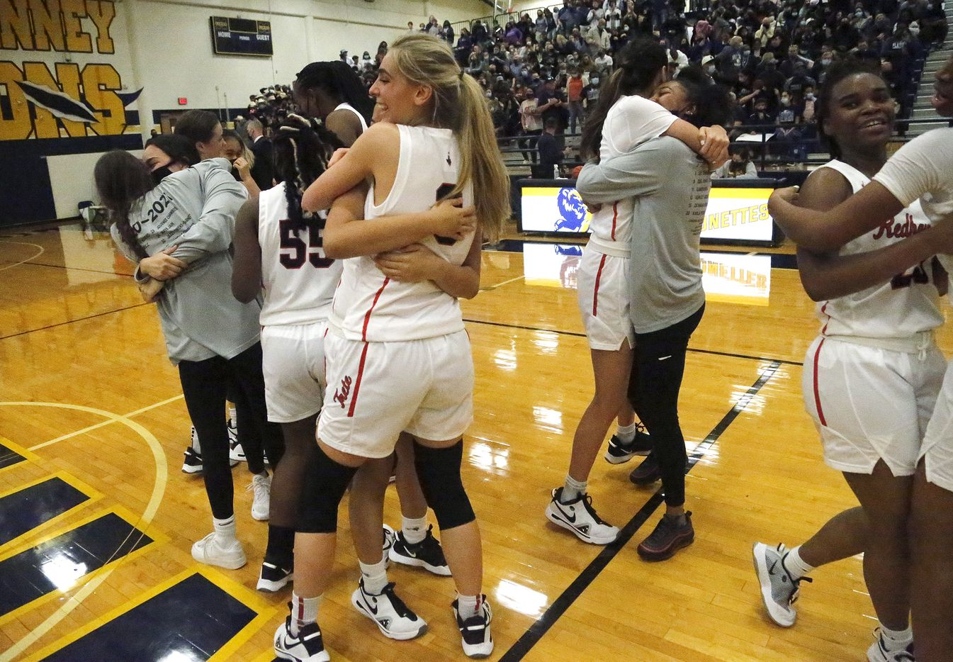 Frisco Liberty High School forward Lily Ziemkiewicz (3) embraces Frisco Liberty High School guard Kamen Wong (11) as the team celebrates victory at mid court as Frisco Liberty High School hosted Wylie East High School in the girls basketball Class 5A Region II final at McKinney High School on Tuesday, March 2, 2021.  (Stewart F. House/Special Contributor)