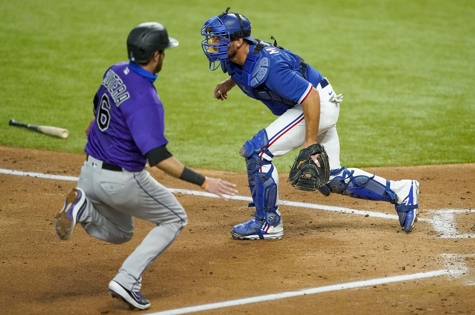 Colorado Rockies catcher Drew Butera scores past Texas Rangers catcher Jeff Mathis during the third inning of an exhibition game at Globe Life Field on Wednesday, July 22, 2020. (Smiley N. Pool/The Dallas Morning News)