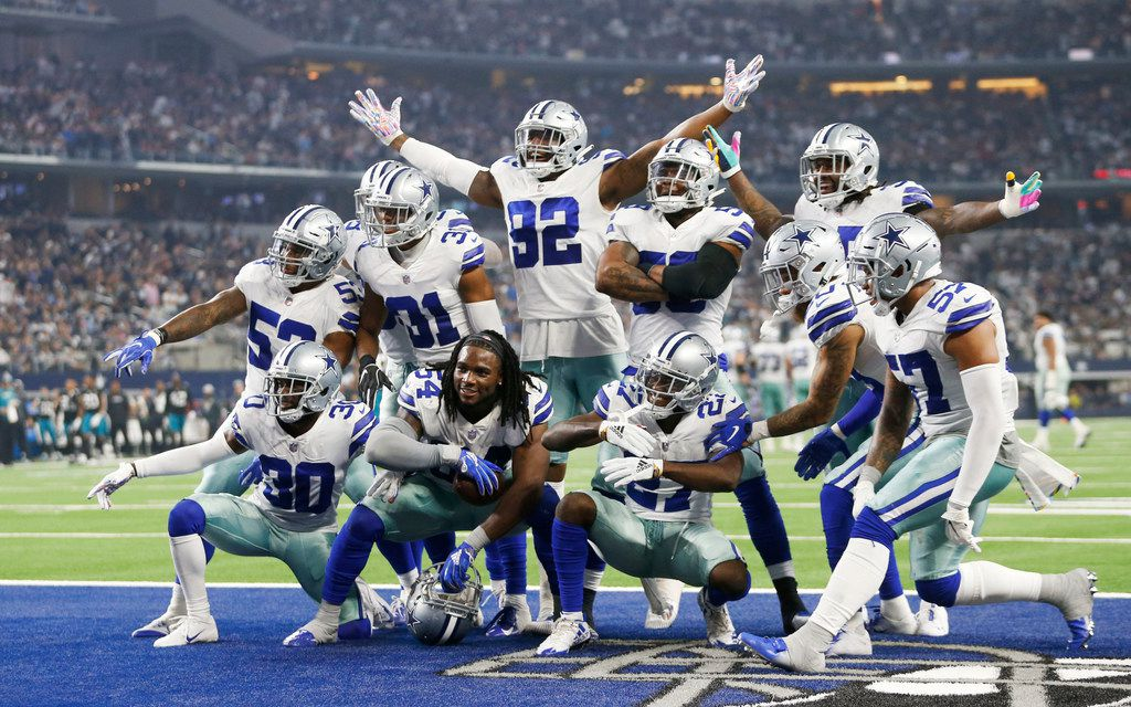 FILE - Cowboys linebacker Jaylon Smith (54) and cornerback Jourdan Lewis (27) pose with defensive teammates after Lewis recovered a forced fumble by Smith in the third quarter of a game against the Jacksonville Jaguars at AT&T Stadium in Arlington on Sunday, Oct. 14, 2018. (Vernon Bryant/The Dallas Morning News)