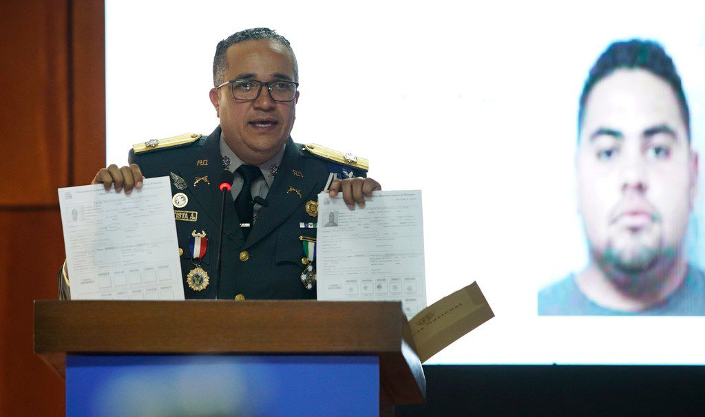 The director of the Dominican Republic's National Police, General Ney Aldrin Bautista Almonte, gives a press conference about the intellectual authors of the attack on former Boston Red Sox slugger David Ortiz, in front of an image of a man identified by authorities as Victor Hugo Gomez in Santo Domingo on Wednesday. According to Bautista Almonte, Ortiz was shot by a gunman who mistook him for the real target, Sixto David Fernandez, who was seated at the same table with the former baseball star on the night of June 9, and the attempted murder was ordered from the United States by Victor Hugo Gomez, Fernandez's cousin and an associate of Mexico's Gulf Cartel.