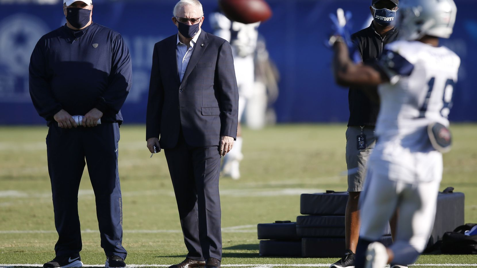 FILE - Cowboys head coach Mike McCarthy and team owner/general manager Jerry Jones watch wide receiver Aaron Parker (18) run through drills during training camp at The Star in Frisco on Friday, Aug. 21, 2020.