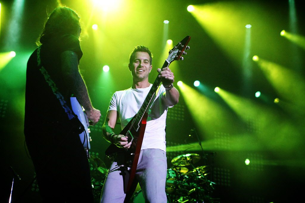 311 vocalist and guitarist, Nick Hexum (left) plays along with lead guitarist, Tim Mahoney, during the band's Unity Tour 2011 performance at Gexa Energy Pavilion.