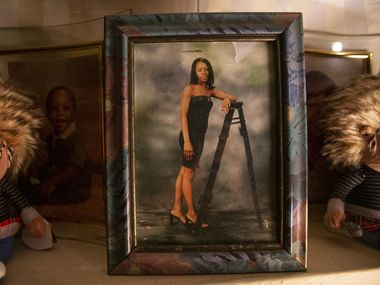"""Alvin Ross said he was """"completely and utterly devastated"""" by the grand jury's decision concerning the death of her sister, Diamond Ross, shown in a photo that sat atop a mantle at the home of their mother, Ethelyn Ross."""