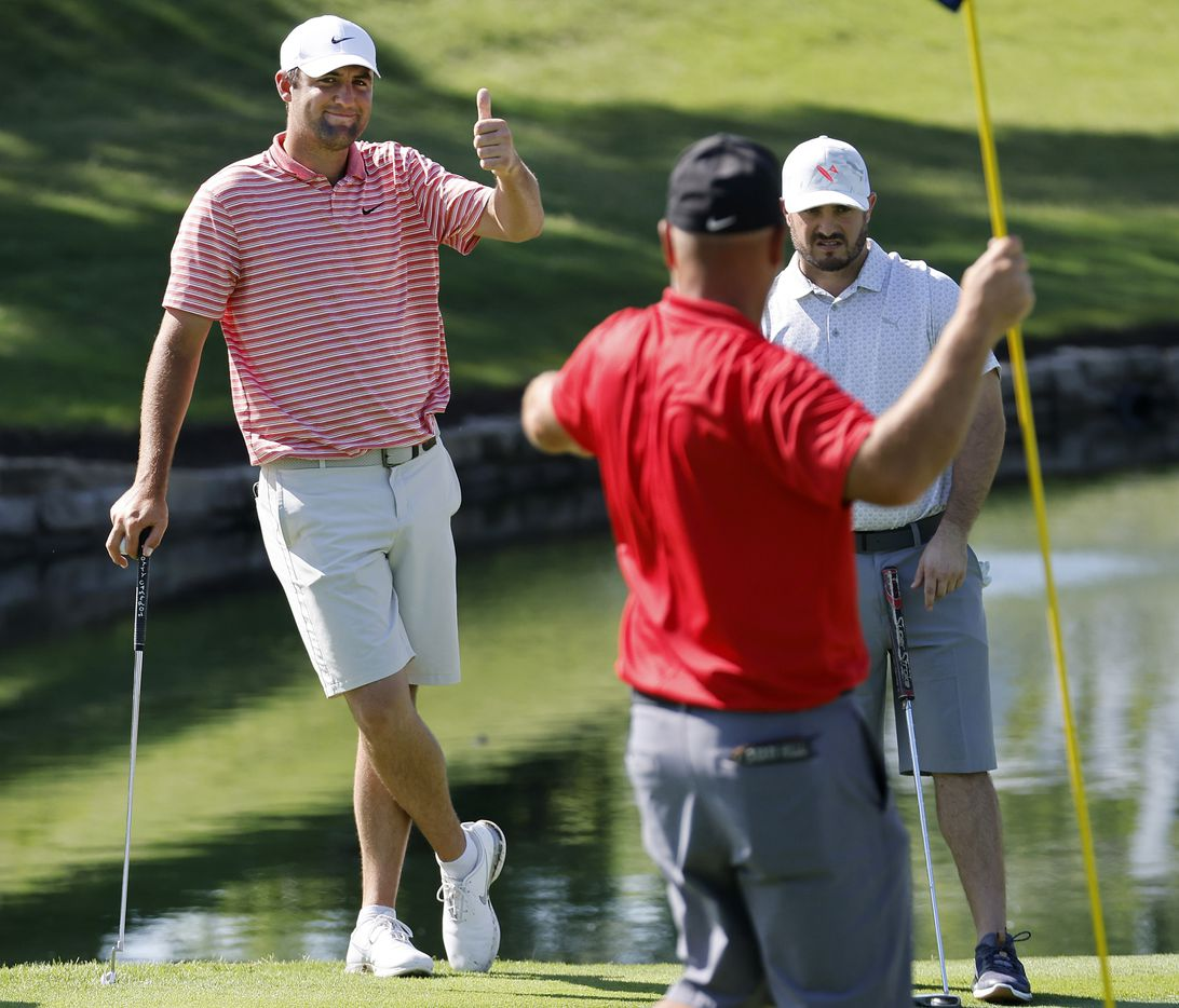 Golfer Scottie Scheffler of Dallas (left) gives a thumbs up to his playing partner during their Charles Schwab Challenge Colonial Pro-Am round at the Colonial Country Club in Fort Worth, Wednesday, May 26, 2021. (Tom Fox/The Dallas Morning News)