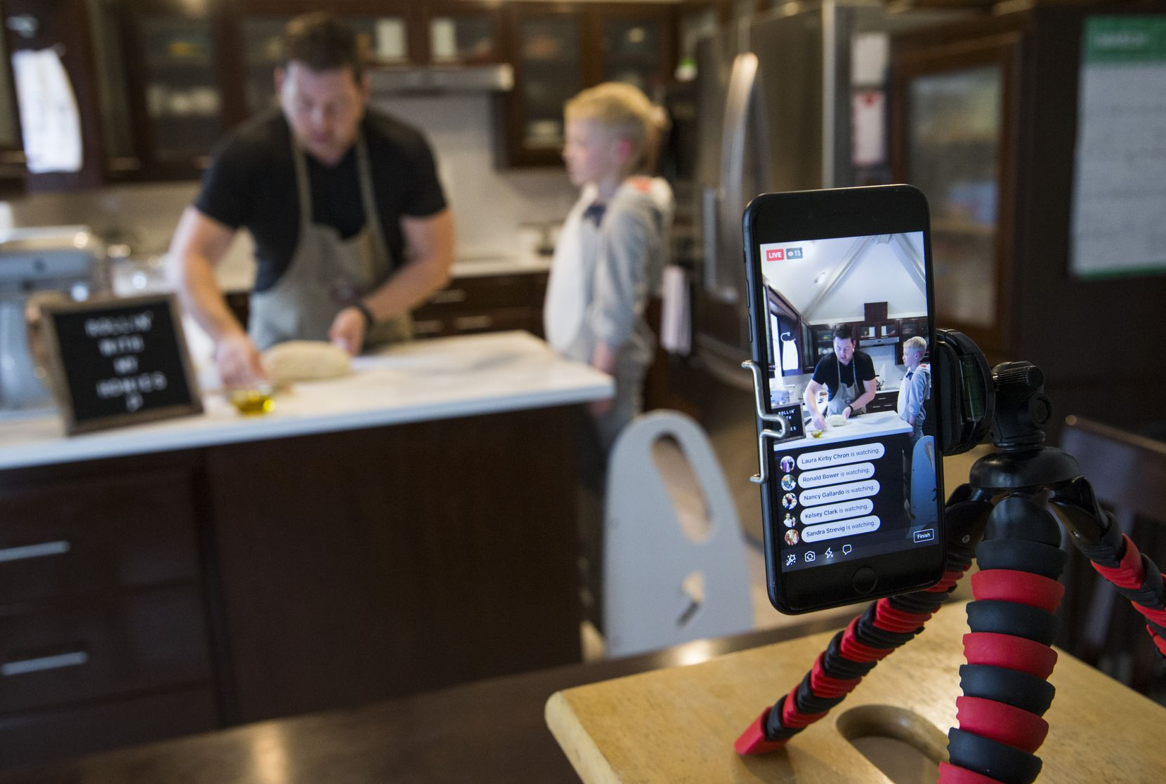 Chef Joe Baker of Joe the Baker and his son, Blais Baker, 5, who is dressed as a shark, host an online baking tutorial using Facebook Live from their kitchen in Coppell.
