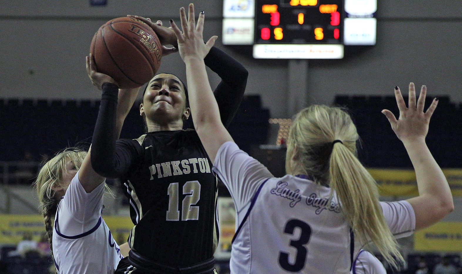 Tamia Flores (12), left, puts up a shot for Pinkston during the Texas UIL Girls 4A state semi-final game against Canyon in San Angelo, TX on Saturday, March 6, 2021. (Colin Murphey/Special Contributor)