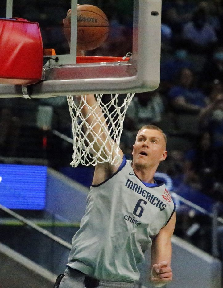 Dallas Mavericks center Kristaps Porzingis (6) goes up fro a dunk as the Dallas Mavericks held their Mavs Fam Jam, a scrimmage free to the public at the American Airlines Center in Dallas on Sunday, October 3, 2021. (Stewart F. House/Special Contributor)