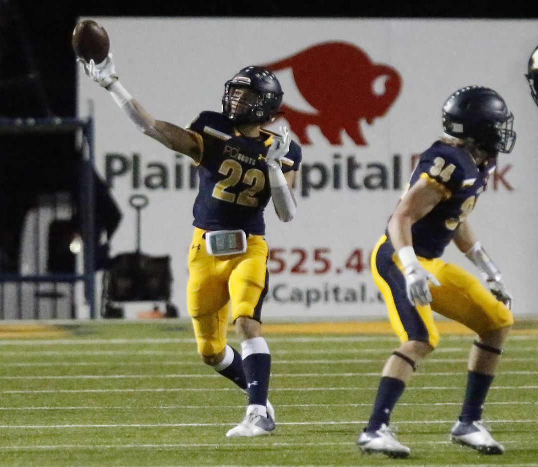 Highland Park High School wide receiver Luke Rossley (22) throws the football on a flea flicker play during the first half as Highland Park High School hosted Longview High School at Highlander Stadium in Dallas on Friday night, October 8, 2021. (Stewart F. House/Special Contributor)