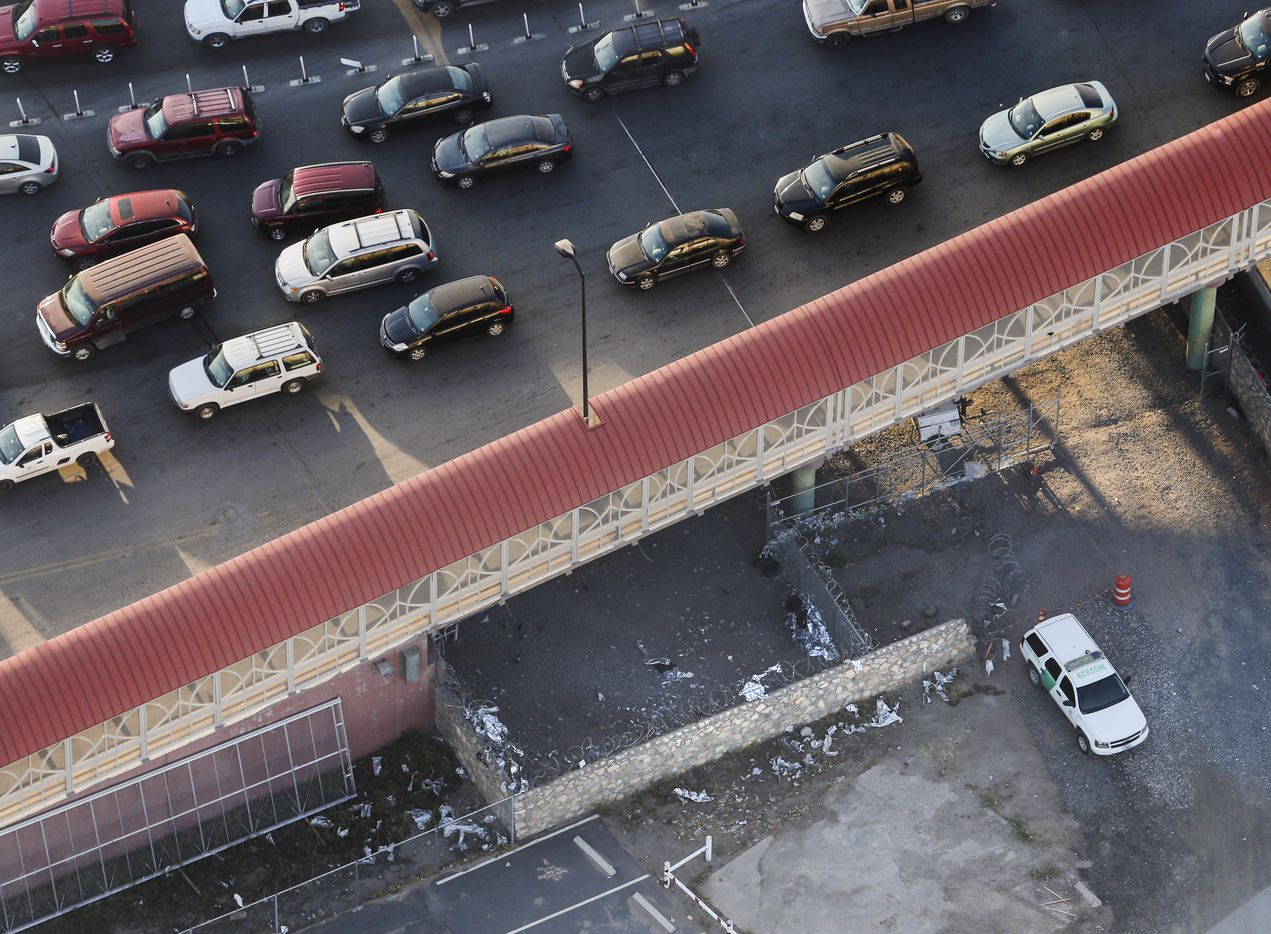Shreds of Mylar blankets and a Border Patrol vehicle are seen under the Paso del Norte Port of Entry bridge in El Paso, Texas, on Sunday, March 31, 2019 after the makeshift facility was closed.